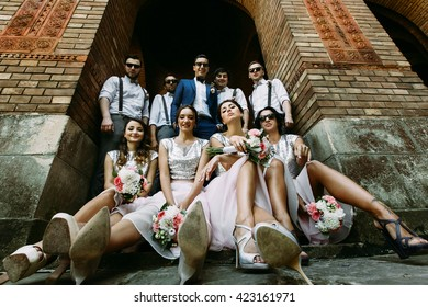 Funny bridesmaids and groomsmen with a groom