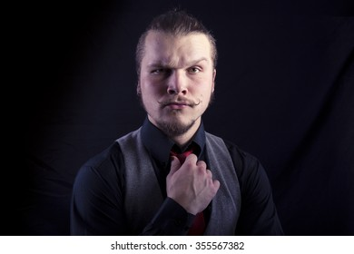 Funny business man on black background