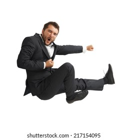 funny businessman in black suit kicking as karate. isolated on white background
