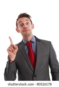 Funny businessman pointing his finger up while looking at you.