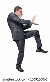 Funny businessman is preparing to fight isolated on white background. Office combat concept. Angry aggressive business man.