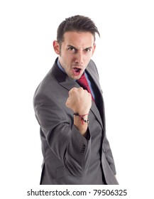 Funny businessman raising his fist in sign of victory