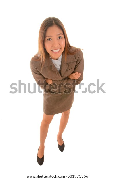 Funny businesswoman in brown suit  is crossing arm.