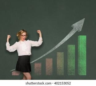 Funny businesswoman happy statistics financial profit rising bar graph chalkboard blackboard space