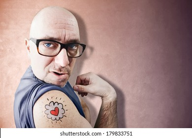 Funny and charming Latin Lover shows his tattoo
