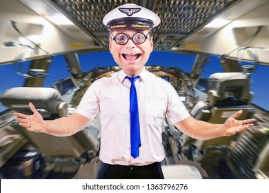Funny cheerful pilot with glasses, background of cockpit plane. Crazy captain of air plane with white shirt uniform standing in cabin of aircraft.