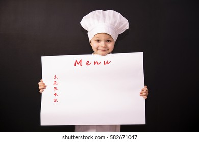 funny chef holding a white sheet of paper