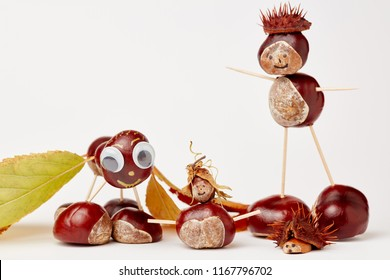 Funny chestnut tinker man with chestnut figures in autumn