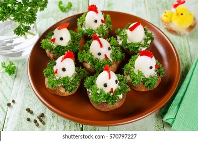 Funny chickens from eggs on the Easter table. Appetizer of mushrooms and quail eggs