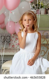 Funny child with candy lollipop. Kid eat sweets