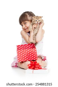 funny child girl holding gift box with kitten isolated