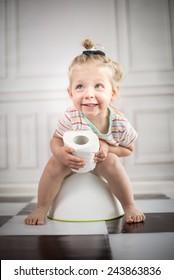 funny child girl sitting on chamberpot