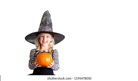 Funny child girl in witch costume for Halloween with pumpkin Jack  isolated on white background. Happy Halloween.