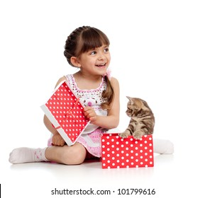 funny child with kitten in gift box