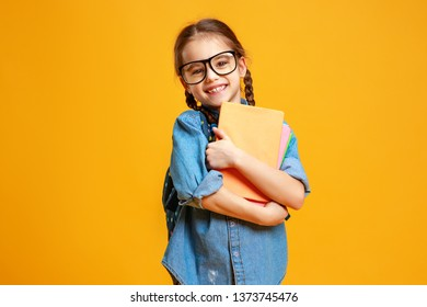 funny child school girl girl on a yellow background