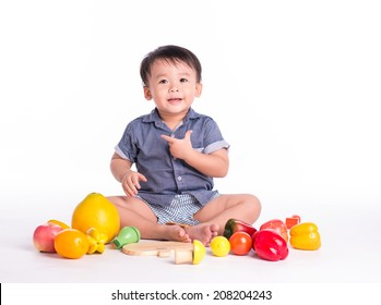 Funny children baby with healthy food fruits isolated on white background smiling