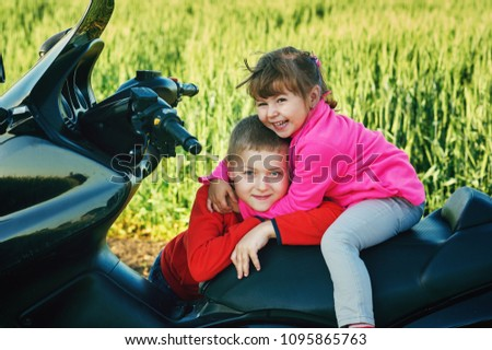 Funny Children On Motorcycle Brother Sister Stock Photo Edit Now