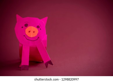 Funny children's hack of color paper. Symbol of the new year in the Chinese calendar year of the pig. Copy space.