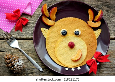 Funny Christmas breakfast of pancakes in the form of a deer