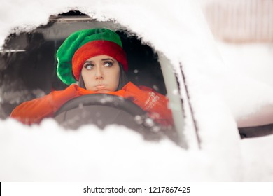 Funny Christmas Girl Driving Through the Snow on Bad Weather. Santa driver stuck on snowfall storm being late for Xmas