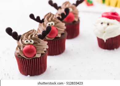 Funny Christmas reindeer cupcake. Delicious gift for x'mas or new year.