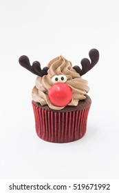 Funny Christmas reindeer cupcake. Delicious gift for x'mas or new year. on white background