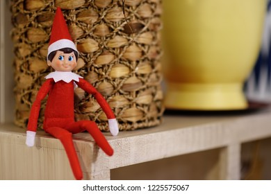 Funny Christmas toy elf on shelf. American christmas traditions. Xmas activities for family with kids.