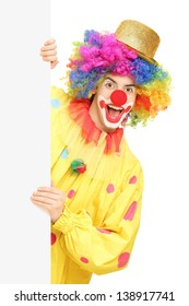 Funny circus clown holding a blank panel isolated on white background