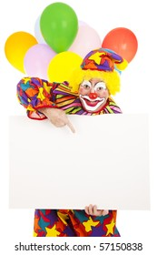 Funny circus clown holding a blank white card, ready for your message.  Isolated.