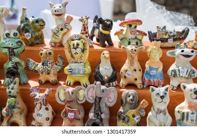 Funny clay figurines of animals for sale. The lion hold israeli flag