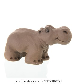 funny clay hippo isolated over white background