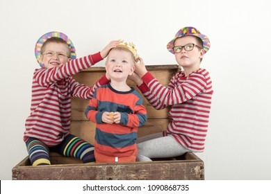 Funny clown children dressed up in costumes and represent circus. Child is playing at home. Hat is bowler and yellow patch on nose. 1 April. Concept of a fool's day. Copy space.