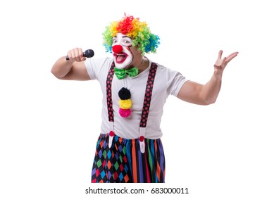 Funny clown with a microphone singing karaoke isolated on white