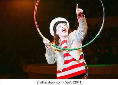 Funny clown performs at the circus.