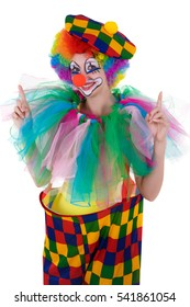 Funny clown is pointing happy upward onto copy space