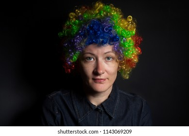 Funny clown woman isolated on black background