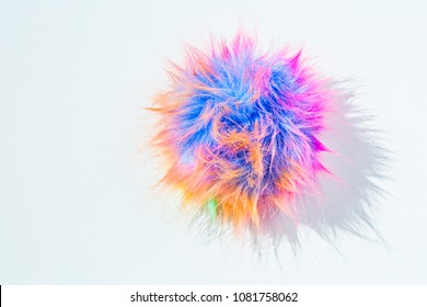 Funny colorful rainbow colors pom-pom. The challenge of everyday life and gray shades. Bright colors of life and joy concept