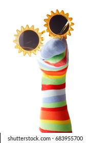 Funny colorful sock puppet with sunglasses isolated on white background