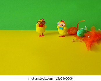 A funny couple of chicks, a male and a female, and some different ornamented easter eggs