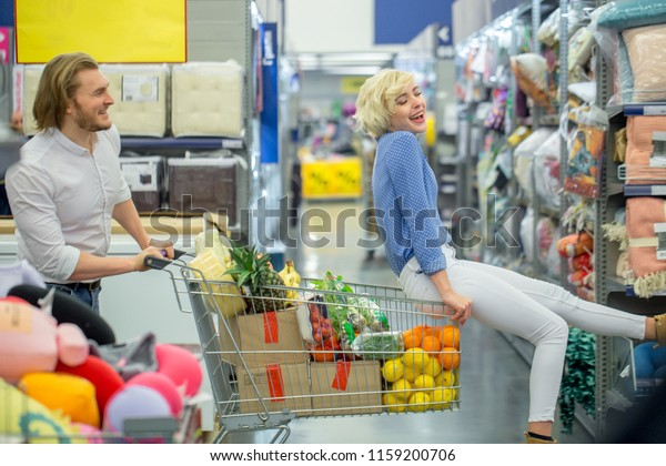 Funny Couple Having Fun While Choosing Stock Photo Edit Now