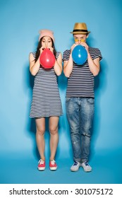 funny couple in love with balls in the studio