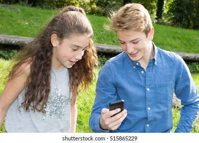 Funny couple playing games with a smart phone