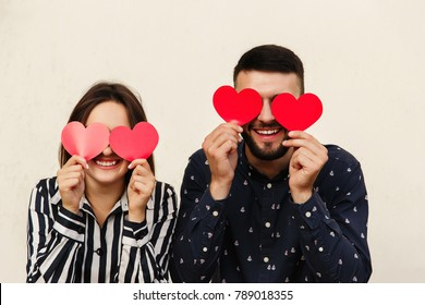 Funny couple with red heart at valentines day. Romantic emotion at first date. Love concept