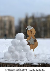 Funny Crank in a Snow Collapse. Snow Wall and funny toy
