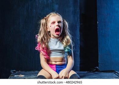 The funny crasy girl on dark background