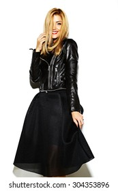 Funny crazy glamor stylish sexy smiling beautiful blond young woman model in black hipster clothes in studio