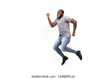 Funny creative black man in fantasy having fun one on white background jump, dance, running to dream, copy space for logo or advertising, African American, success concept, happy worker going to job
