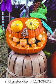 Funny creepy pumpkin carving face in autumn