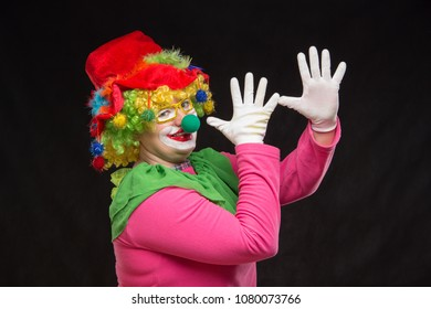 Funny curly clown in shiny glasses with good cheerful emotions