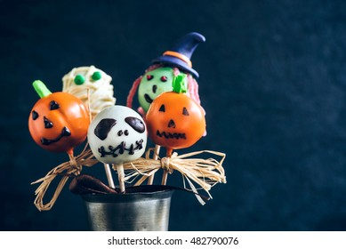 Funny delicious cake pops for Halloween on the table,selective focus and blank space